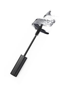 Black mascara brush stroke with applicator brush