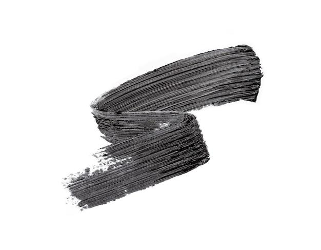 Black mascara brush strokes on white