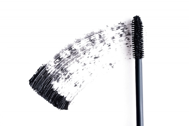 Black mascara smears on white background