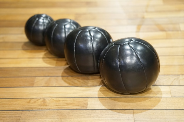 Black medicine balls for muscle building and sport games