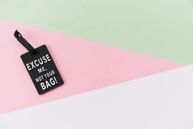 Black message tag on colored background