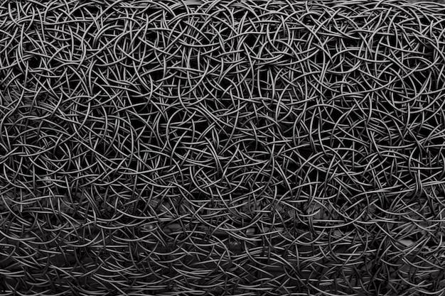 Black messy metal wire braiding. steel textured background.