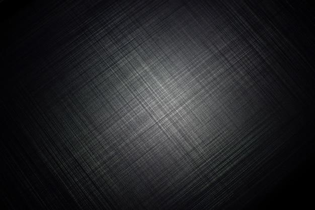 スポットライトの光で黒い金属の縞模様のテクスチャ背景