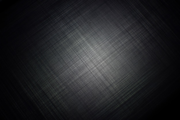 Black metal striped textured background with a light of spotlight