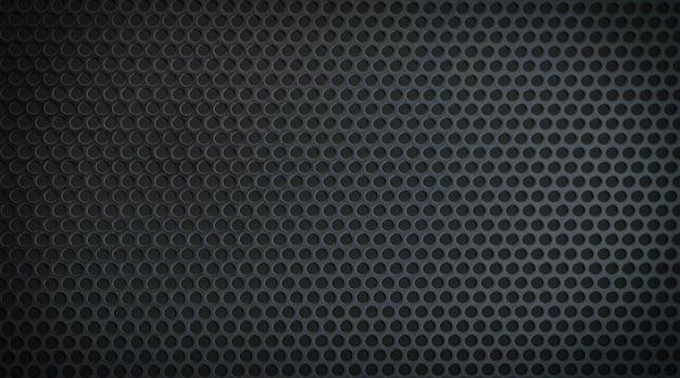 둥근 구멍이 있는 검은색 금속 질감