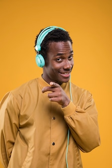 Black model posing with headphones