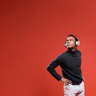 Black model posing with headphones