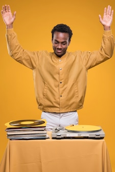 Black model posing with vinyls