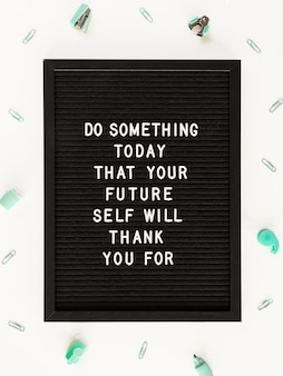 Black motivational text board flat lay