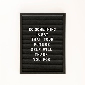 Black motivational text board  top view