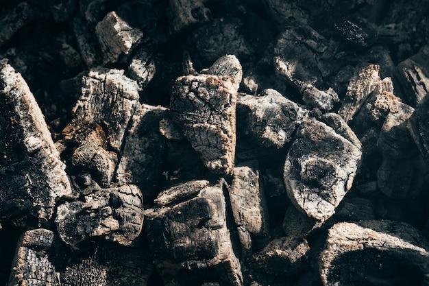 Black natural coals after a fire