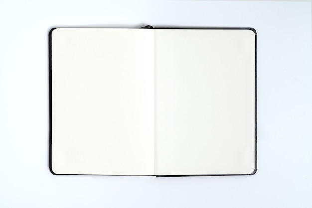 Black notebook on white background with clipping path