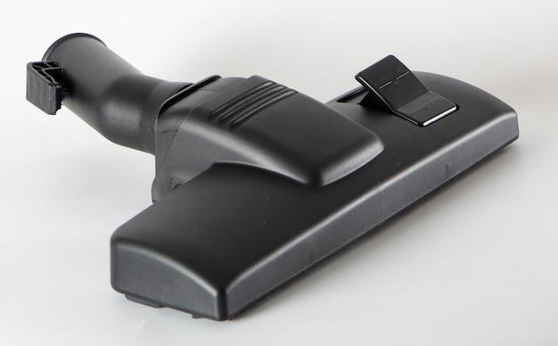 Черная насадка для пылесоса на белом фоне крупным планом
