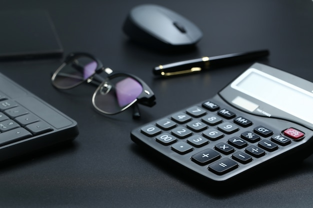 Black office business equipment on black background