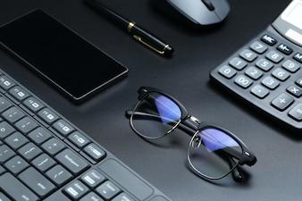 Black office business equipment on black background