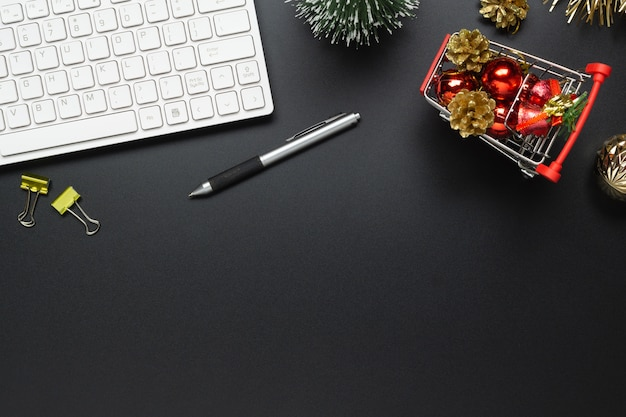 Black office desktop table with christmas ornaments on shopping cart