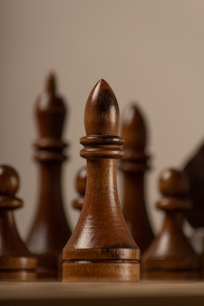 Black officer against the background of the rest of the chess pieces
