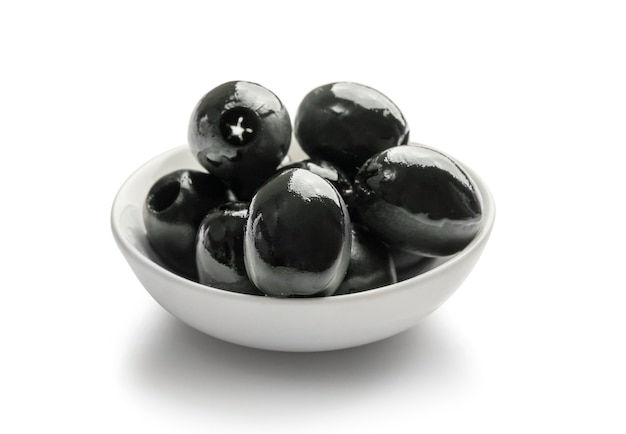 Black olives in small bowl isolated on white.