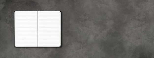 Black open lined notebook mockup isolated on dark concrete background. horizontal banner