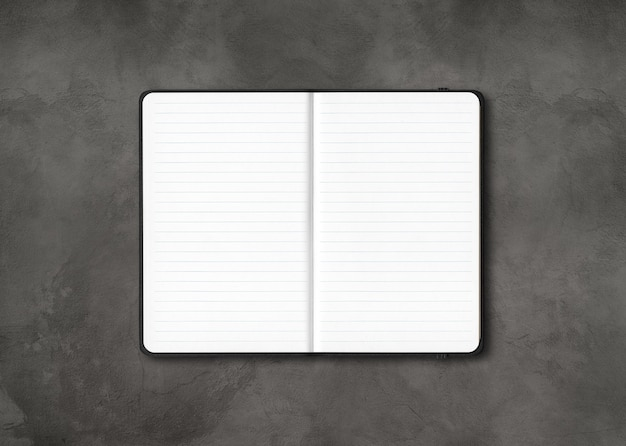 Black open lined notebook mockup isolated on dark concrete background