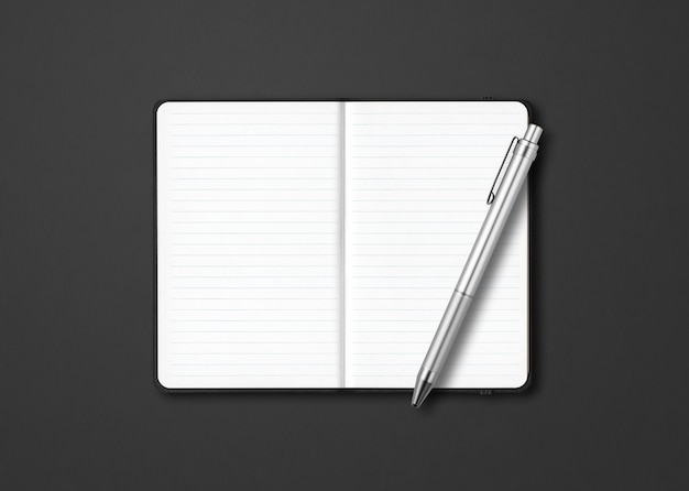 Black open lined notebook  with a pen isolated on dark background