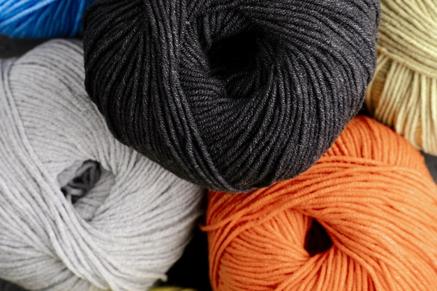 Black, orange and white wool yarn