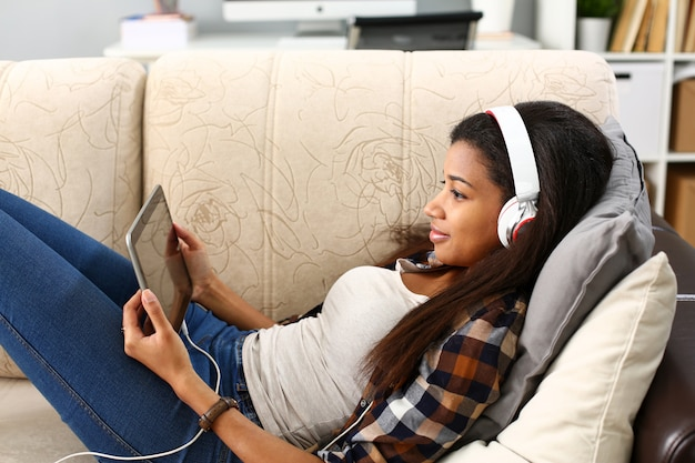 Black ordinary female american teen portrait at home sofa remote education concept.