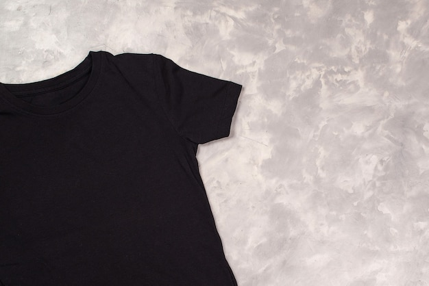 Black paint t-shirt with copy space. t-shirt mockup, flat lay.