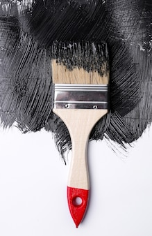 Black paint on a white background