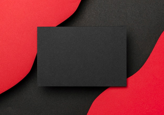 검은 종이 빨간색 배경의 물결 모양 레이어