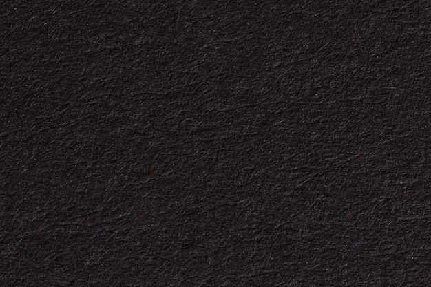 Black paper background or texture with vignette. high resolution photo.