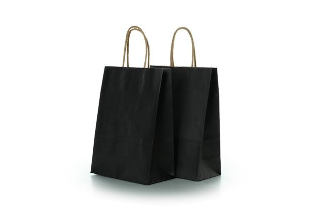白で隔離の黒い紙袋