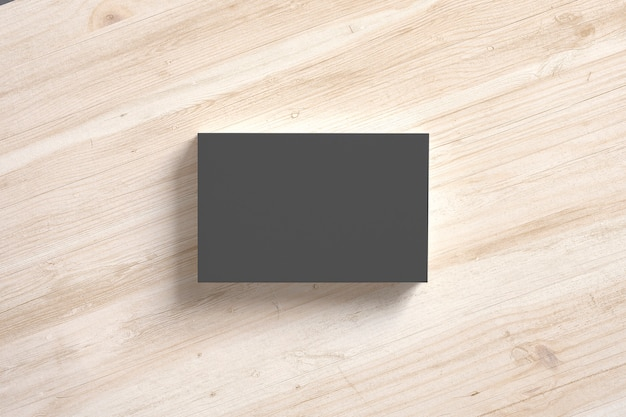 Black paper business cards stack on wooden desks. template to showcase your presentation.
