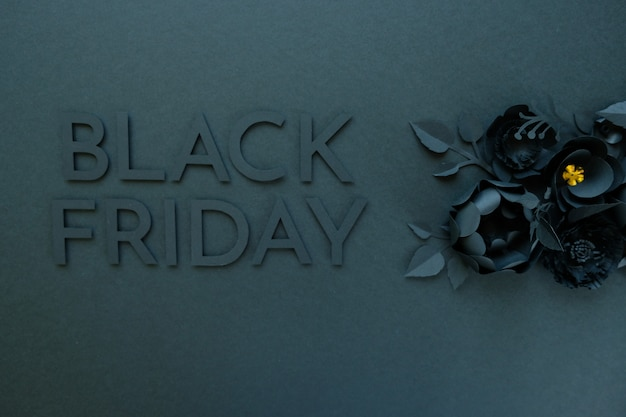 Black paper flowers on black background
