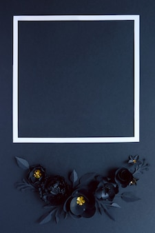 Black paper flowers on black. cut from paper.