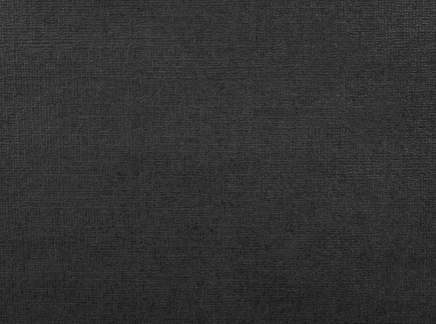 Black paper texture. background of dark material made from cardboard.