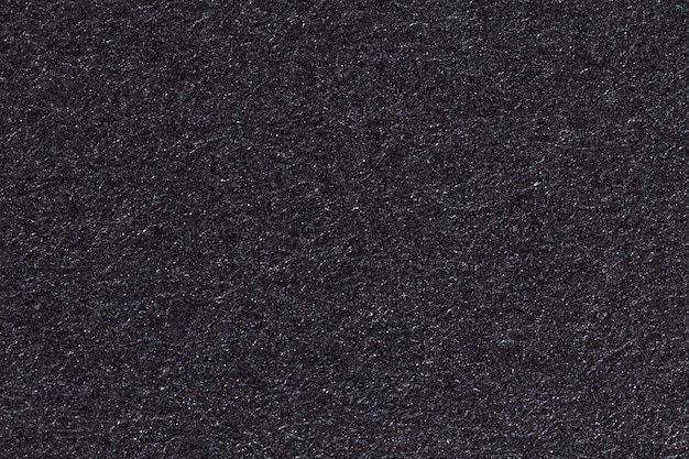 Black paper texture or background. high resolution photo.