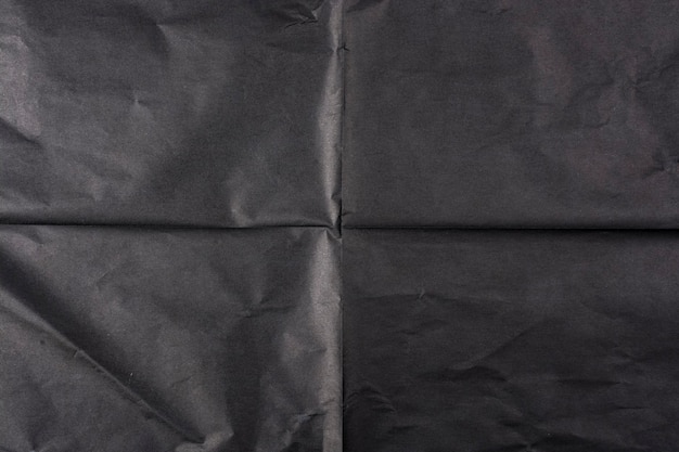 Black paper with folds. paper texture.