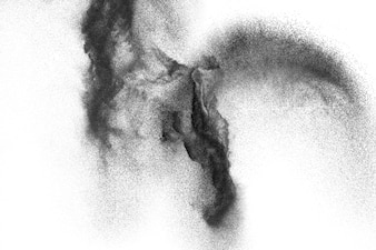 Black particles splattered on white background. Black powder dust splashing.