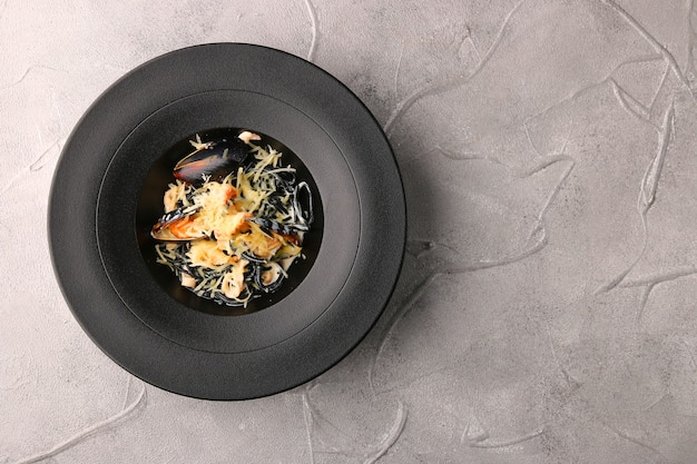 Black pasta with mussels and cheese