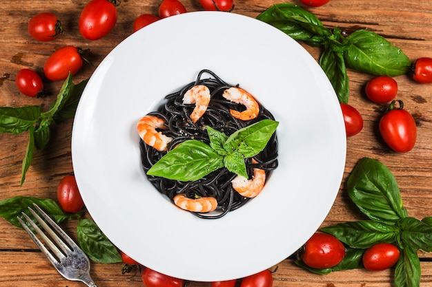 Black pasta with seafood. traditional italian cuisine - homemade pasta with shrimp,