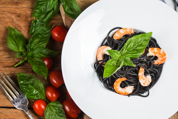 Black pasta with seafood. traditional italian cuisine - homemade pasta with shrimp
