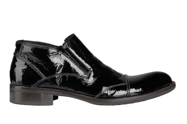 黒のパテントレザーの男性の靴は白で隔離
