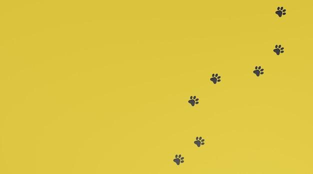 黄色の背景に黒い足跡。犬または猫の足跡