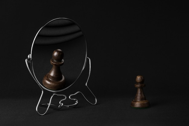 Black pawn admiring himself in the mirror