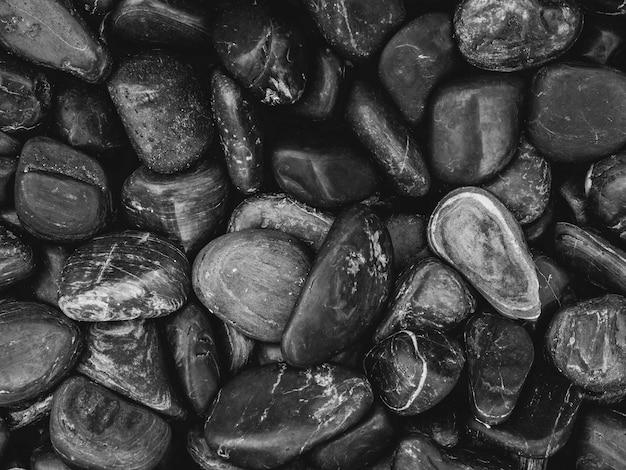 Черная галька крупным планом Premium Фотографии