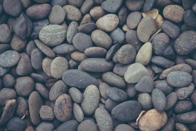 Black pebbles stone background  with vintage filter