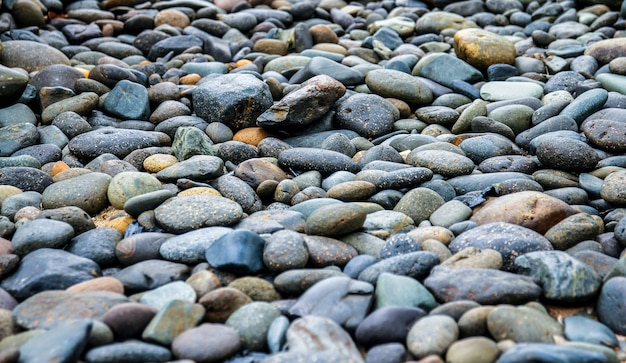 Black pebbles stone background
