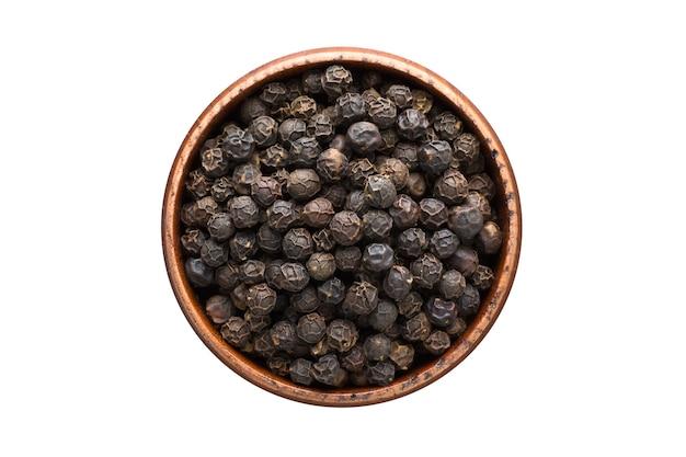 分離された木製のボウルに黒胡椒の粒のスパイス。調味料上面図