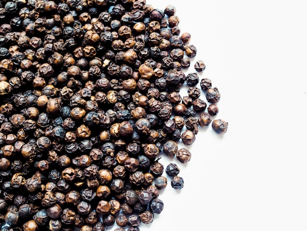 Black peppercorn for background with white copy space